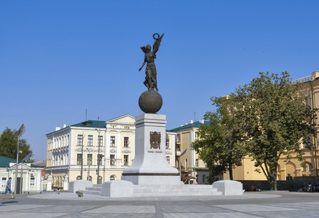 proclamation: KHARKIV, UKRAINE - JULY 25, 2014: People walk and have a rest near Monument of Independence Flying Ukraine erected in 2012. It was inaugurated on Constitution Square in honor of the proclamation of Independence of Ukraine on 24 August 1991.
