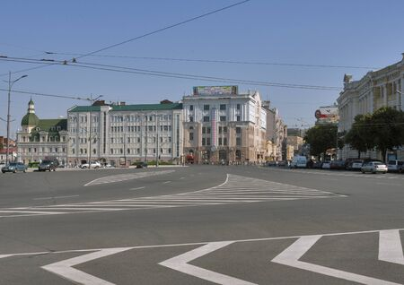 kharkov: KHARKIV, UKRAINE - JULY 25, 2014: Street traffic along Sumskaya street, the central street of Kharkiv city. Rightside is the Puppet Theater founded in 1935, leftside is the Constitution square founded in 1659.