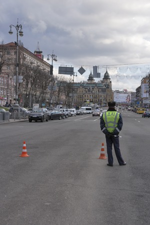 militiaman: KIEV, UKRAINE - APRIL 5, 2015: State Traffic Police DAI serves on Khreshchatyk city street. National Police replaced DAI in July 2015 as a part of reforms launched by Ukrainian president Poroshenko. Editorial