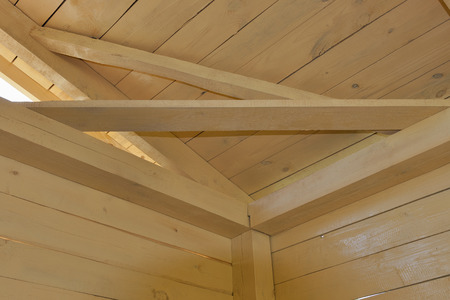 roof ridge: interior view of the construction of a pitched roof showing the ridge, rafters and sheathing