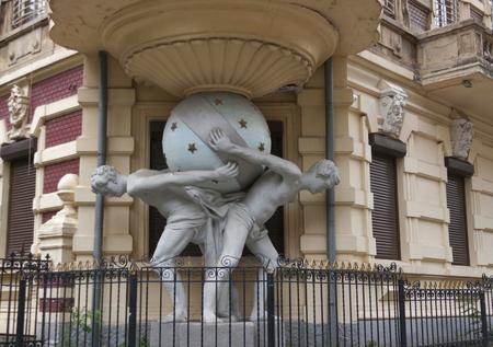 atlantes: House with atlantes statue in historical area of Odessa, Ukraine Editorial