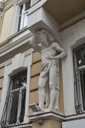 atlantes: House with atlantes statue in historical area of Odessa, Ukraine Stock Photo
