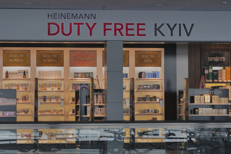 exempt: KIEV, UKRAINE - FEBRUARY 08, 2015: Heinemann Duty Free shop display in Kyiv Boryspil International Airport. Duty free shops are retail outlets that are exempt from the payment of certain taxes.