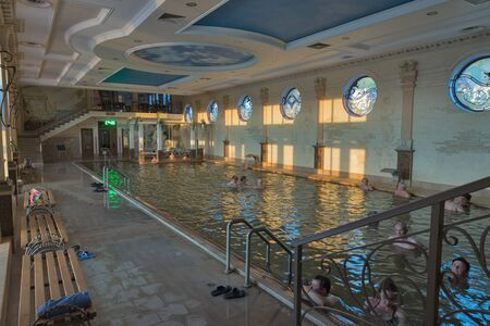 salinity: BEREHOVE, UKRAINE - SEPTEMBER 02,2015: Unrecognizable people swim in indoor thermal spa pool Zhayvoronok. Berehove city became famous for its unique thermal healing waters of high salinity.