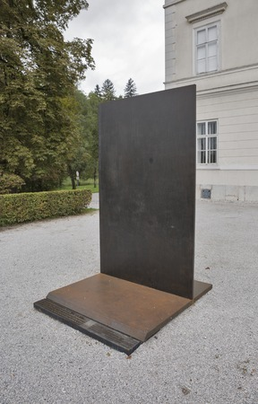 critic: LJUBLJANA, SLOVENIA - SEPTEMBER 04, 2015: Modern monument to Zoran Krzisnik, Slovenian art historian and art critic. Monument was erected by the city of Ljubljana in 2011 in front of Tivoli Castle.