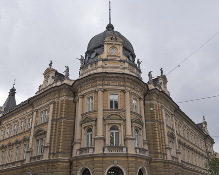 three story: Post Office in Ljubljana, Slovenia. Completed in 1896, the ochre colored building features a beautiful three story tower capped by a windowed dome with a clock topped by an eagle with outstretched wings. Editorial