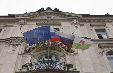 ljubljana: Flags of EU, Slovenia and Ljubljana city in Ljubljana, Slovenia