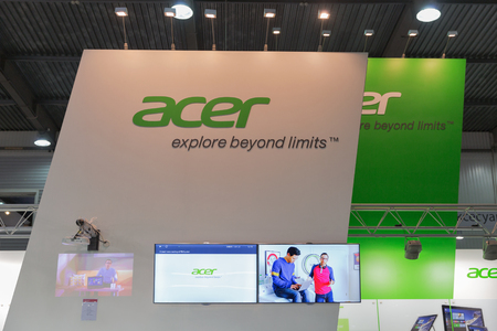 hall monitors: KIEV, UKRAINE - OCTOBER 11, 2015: Acer, a Taiwan based international computer company booth during CEE 2015, the largest electronics trade show of Ukraine in ExpoPlaza Exhibition Center. Editorial