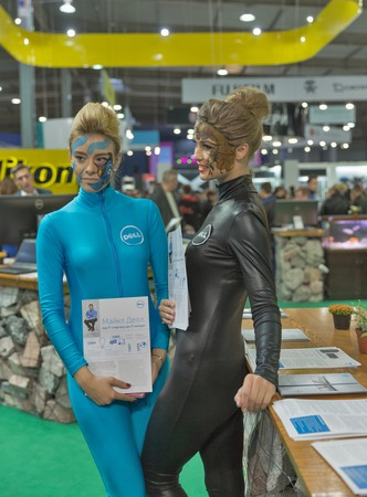 hall monitors: KIEV, UKRAINE - OCTOBER 11, 2015: Girls presenters work on Dell computers company booth during CEE 2015, the largest electronics trade show of Ukraine in ExpoPlaza Exhibition Center. Editorial