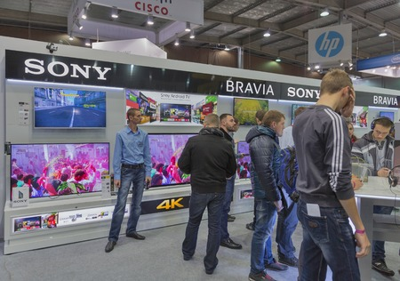 hall monitors: KIEV, UKRAINE - OCTOBER 11, 2015: People visit Sony Bravia, electronics manufacturer company booth during CEE 2015, the largest electronics trade show of Ukraine in ExpoPlaza Exhibition Center