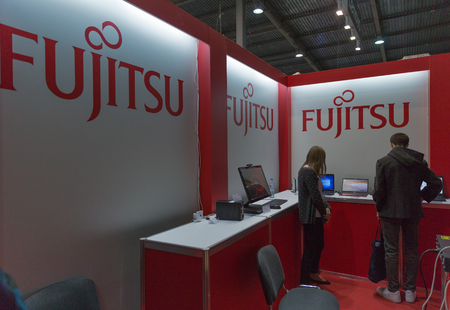 KIEV, UKRAINE - OCTOBER 11, 2015: People visit Fujitsu, Japanese information technology company booth during CEE 2015, the largest electronics trade show of Ukraine in ExpoPlaza Exhibition Center