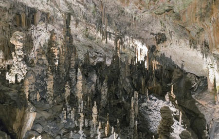 caving: Formations inside cave with stalactites and stalagmites. Postojna cave, Slovenia.