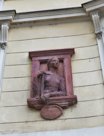 unrequited love: Ancient bas relief on building wall in Ljubljana, Slovenia. Primicova Julija was unrequited love of famous Slovenian poet France Preseren. The bronze poet looks in the direction of Wolfova Street, the home of his love.