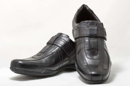sport shoe: Pair of black man leather shoes with velcro on white background