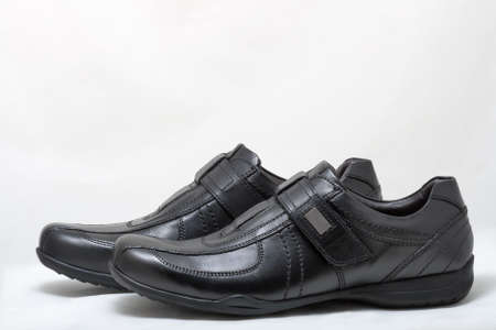 velcro: Pair of black man leather shoes with velcro on white background