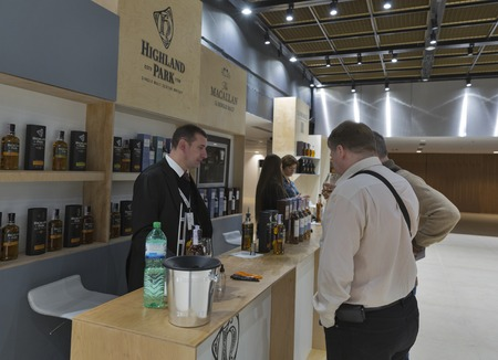 dram: KIEV, UKRAINE - NOVEMBER 21, 2015: Unrecognized people visit Highland Park and Macallan Single Malt Scotch Whisky distilleries booth at 1st Ukrainian Whisky Dram Festival in Parkovy Exhibition Center. Editorial