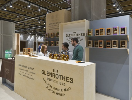 dram: KIEV, UKRAINE - NOVEMBER 21, 2015: Unrecognized presenters work on The Glenrothes Speyside Single Malt Scotch Whisky distillery booth at 1st Ukrainian Whisky Dram Festival in Parkovy Exhibition Center. Editorial