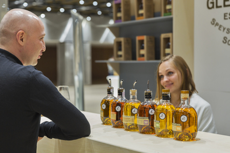 unrecognized: KIEV, UKRAINE - NOVEMBER 21, 2015: Unrecognized man visits The Glenrothes Speyside Single Malt Scotch Whisky distillery booth at 1st Ukrainian Whisky Dram Festival in Parkovy Exhibition Center.