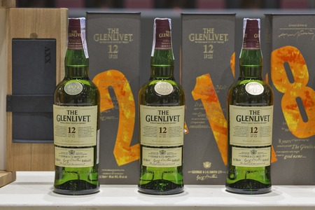 dram: KIEV, UKRAINE - NOVEMBER 21, 2015: The Glenlivet 12 years old Single Malt Scotch Whisky bottles closeup in a row for tasting on booth at 1st Ukrainian Whisky Dram Festival in Parkovy Exhibition Center