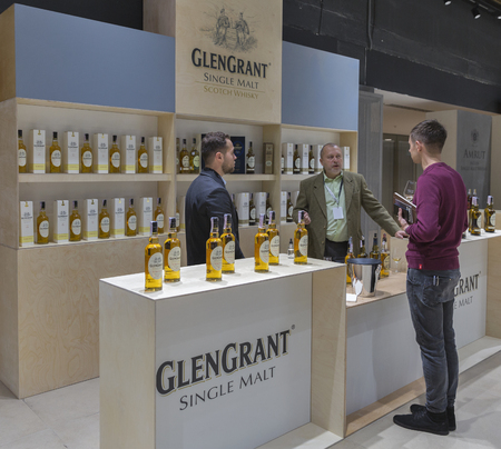 unrecognized: KIEV, UKRAINE - NOVEMBER 21, 2015: Unrecognized man visits Glen Grant Speyside  Single Malt Scotch Whisky distillery booth at 1st Ukrainian Whisky Dram Festival in Parkovy Exhibition Center. Editorial