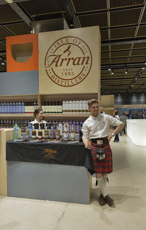 dram: KIEV, UKRAINE - NOVEMBER 21, 2015: Andy Bell, Regional Sales Manager, presents The Arran Single Malt Scotch Whisky distillery booth at 1st Ukrainian Whisky Dram Festival in Parkovy Exhibition Center.