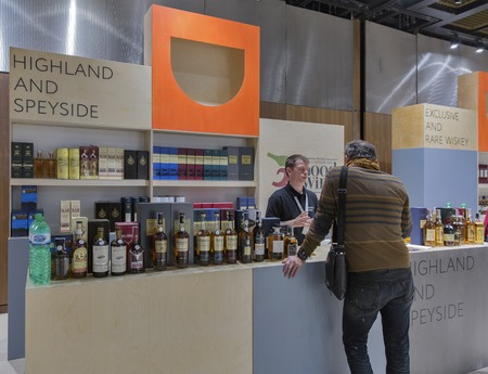 dram: KIEV, UKRAINE - NOVEMBER 21, 2015: Unrecognized man visits Good Wine Highland and Speyside Single Malt Scotch Whiskey booth at 1st Ukrainian Whisky Dram Festival in Parkovy Exhibition Center. Editorial