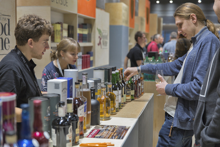 dram: KIEV, UKRAINE - NOVEMBER 21, 2015: Unrecognized people visit Good Wine Highland and Speyside Single Malt Scotch Whiskey booth at 1st Ukrainian Whisky Dram Festival in Parkovy Exhibition Center.