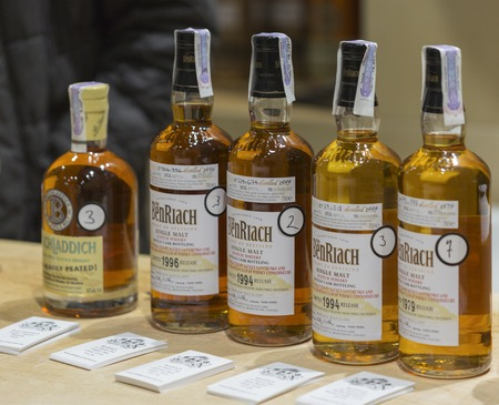 dram: KIEV, UKRAINE - NOVEMBER 21, 2015: The BenRiach Single Malt Scotch Whisky bottles closeup in a row for tasting on booth at 1st Ukrainian Whisky Dram Festival in Parkovy Exhibition Center. Editorial