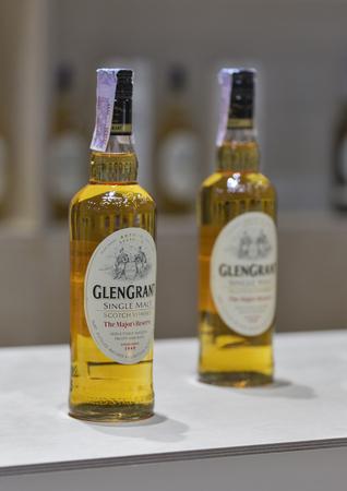 majors: KIEV, UKRAINE - NOVEMBER 21, 2015: Glen Grant Speyside Single Malt Scotch Whisky bottles closeup in a row for tasting on booth at 1st Ukrainian Whisky Dram Festival in Parkovy Exhibition Center.