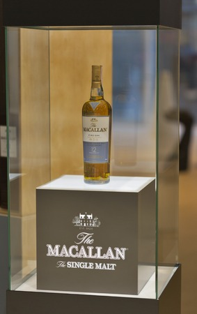 dram: KIEV, UKRAINE - NOVEMBER 21, 2015: Bottle of The Macallan Fine Oak Highland Single Malt Scotch Whisky 12 years old on display at 1st Ukrainian Whisky Dram Festival in Parkovy Exhibition Center. Editorial