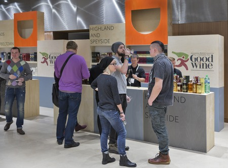 unrecognized: KIEV, UKRAINE - NOVEMBER 21, 2015: Unrecognized people visit Good Wine Highland and Speyside Single Malt Scotch Whiskey booth at 1st Ukrainian Whisky Dram Festival in Parkovy Exhibition Center.
