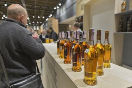 whisky bottle: KIEV, UKRAINE - NOVEMBER 21, 2015: Unrecognized people visit Glenmorangie Single Malt Scotch Whisky Highland distillery booth at 1st Ukrainian Whisky Dram Festival in Parkovy Exhibition Center.
