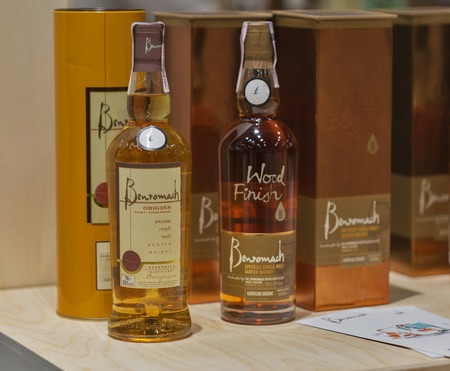 dram: KIEV, UKRAINE - NOVEMBER 21, 2015: Benromach Single Malt Scotch Whisky bottles closeup in a row for tasting on booth at 1st Ukrainian Whisky Dram Festival in Parkovy Exhibition Center.