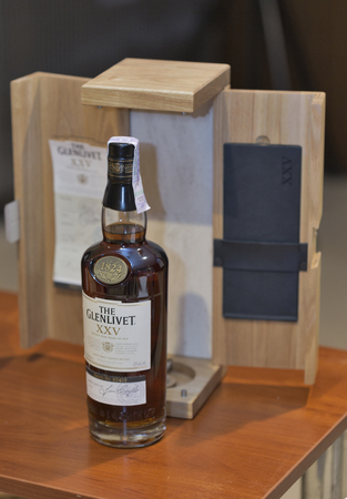 25 years old: KIEV, UKRAINE - NOVEMBER 21, 2015: The Glenlivet 25 years old Single Malt Scotch Whisky bottle and box closeup on display at 1st Ukrainian Whisky Dram Festival in Parkovy Exhibition Center.