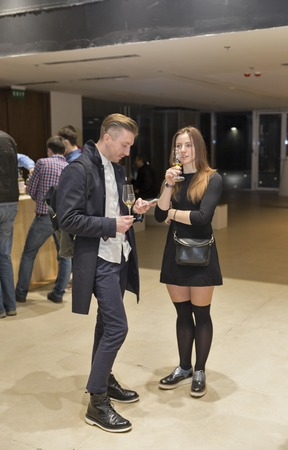 unrecognized: KIEV, UKRAINE - NOVEMBER 21, 2015: Unrecognized young visitors taste samples of Single Malt Scotch Whisky at 1st Ukrainian Whisky Dram Festival in Parkovy Exhibition Center.