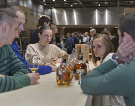 dram: KIEV, UKRAINE - NOVEMBER 21, 2015: Unrecognized young people visit The Glenrothes Speyside Single Malt Scotch Whisky distillery booth at 1st Ukrainian Whisky Dram Festival in Parkovy Exhibition Center.