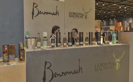 dram: KIEV, UKRAINE - NOVEMBER 21, 2015: Unrecognized presenters work on Benromach and Gordon and MacPhail Single Malt Scotch Whisky booth at 1st Ukrainian Whisky Dram Festival in Parkovy Exhibition Center. Editorial