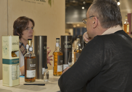 dram: KIEV, UKRAINE - NOVEMBER 21, 2015: Unrecognized man visit Benromach and Gordon and MacPhail Single Malt Scotch Whisky booth at 1st Ukrainian Whisky Dram Festival in Parkovy Exhibition Center.