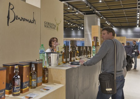 dram: KIEV, UKRAINE - NOVEMBER 21, 2015: Unrecognized people visit Benromach and Gordon and MacPhail Single Malt Scotch Whisky booth at 1st Ukrainian Whisky Dram Festival in Parkovy Exhibition Center. Editorial