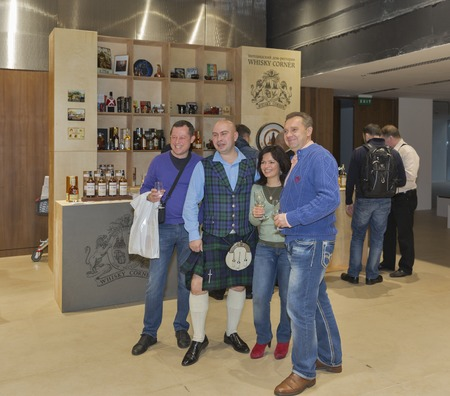 dram: KIEV, UKRAINE - NOVEMBER 21, 2015: Unrecognized people visit Whisky Corner Restaurant booth with Single Malt Scotch Whisky at 1st Ukrainian Whisky Dram Festival in Parkovy Exhibition Center. Editorial