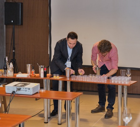 dram: KIEV, UKRAINE - NOVEMBER 21, 2015: Unrecognized presenters prepare cocktail samples with Single Malt Scotch Whisky for tasting at 1st Whisky Dram Festival in Parkovy Exhibition Center.