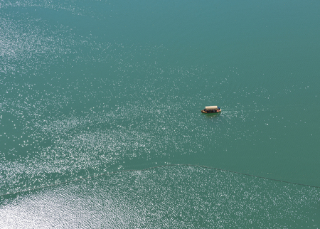 vast: Boat with tourists sailing on the vast water surface of the Lake Bled in Slovenia Stock Photo