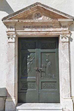 assumption: Church of the Assumption of Mary ancient metal door on lake Bled island in Slovenia