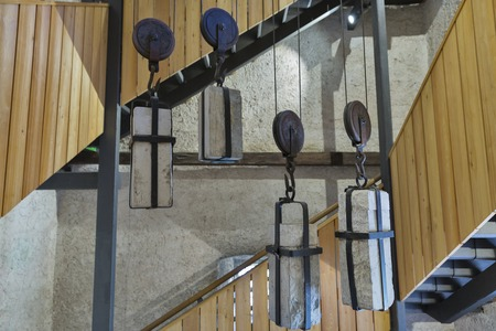 counterweight: Ancient mechanism in Church of the Assumption of Mary clock tower on lake Bled island in Slovenia
