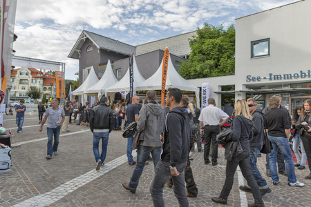 unrecognized: VELDEN, AUSTRIA - SEPTEMBER 08, 2015: Unrecognized people visit exhibition of annual European Bike Week festival. Now it ranks among Europes biggest and best motorcycle events. Editorial