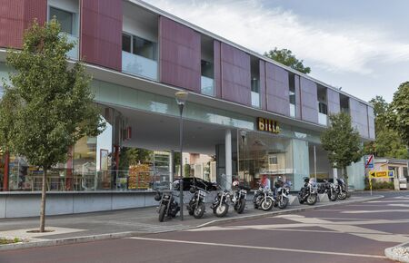 parked bikes: VELDEN, AUSTRIA - SEPTEMBER 08, 2015: Parked bikes in front of Billa supermarket during annual European Bike Week festival. Now it ranks among Europe biggest and best motorcycle events. Editorial