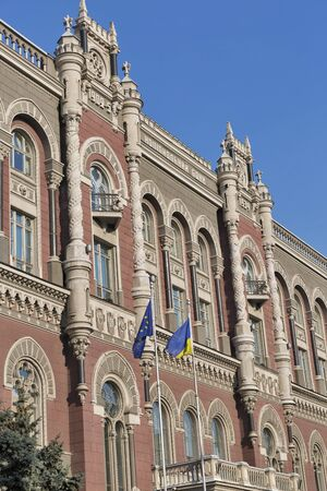 establishment states: Flags of European Union and Ukraine in front of National Bank of Ukraine building in Kiev. Headquarters building was constructed between 1902 and 1934.