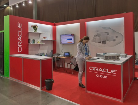 oracle: KIEV, UKRAINE - OCTOBER 11, 2015: Presenter works on Oracle, USA global computer technology corporation booth during CEE 2015, largest electronics trade show of Ukraine in ExpoPlaza Exhibition Center.