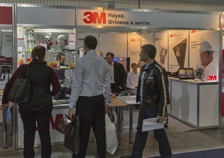 manufacturer: KIEV, UKRAINE - OCTOBER 11, 2015: People visit 3M, American multinational conglomerate corporation booth during CEE 2015, the largest electronics trade show of Ukraine in ExpoPlaza Exhibition Center
