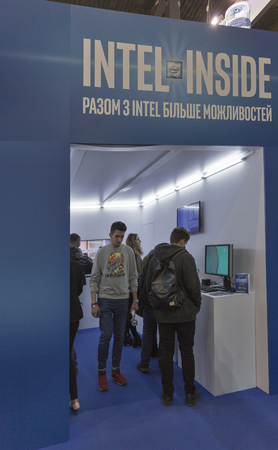 intel: KIEV, UKRAINE - OCTOBER 11, 2015: People visit Intel, American multinational technology company booth during CEE 2015, the largest electronics trade show of Ukraine in ExpoPlaza Exhibition Center Editorial